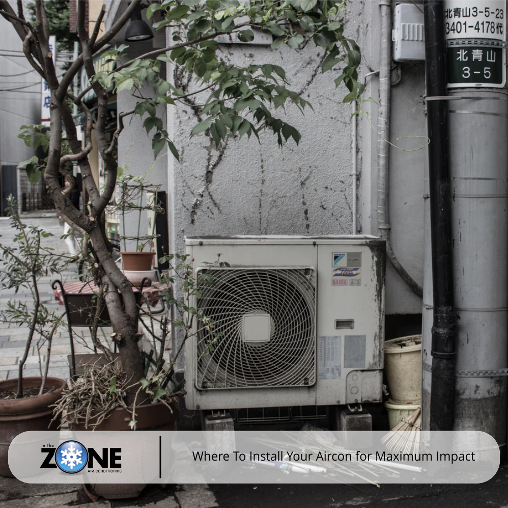 a courtyard featuring an exterior air-conditioning unit